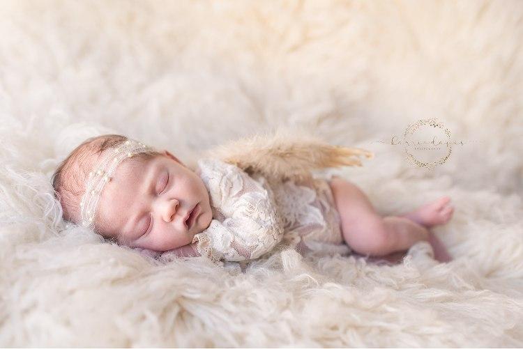 newborn girl as angel