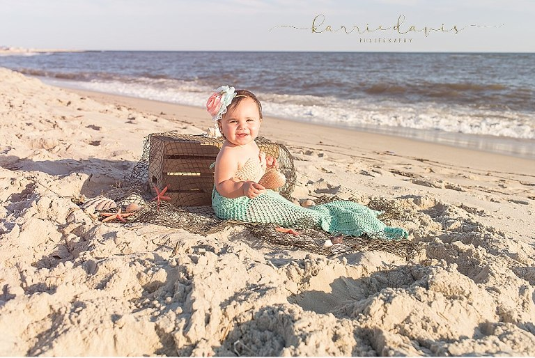 baby girl in mermaid outfit at the beach in Cape May NJ